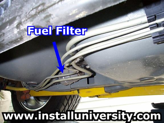 dodge stratus fuel filter location